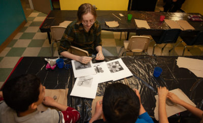 Calla Tait working with students at Sophia House
