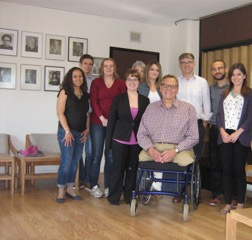 CU students and faculty pose with Gil Loescher.