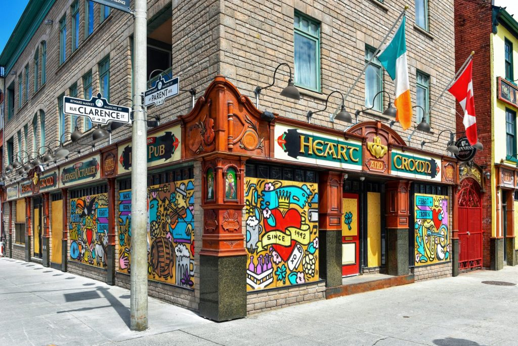 Ottawa, Canada – May 3, 2020: Popular live music locale The Heart and Crown is boarded up during the COVID-19 lockdown measures. Owners of The Heart and Crown commissioned local artist Falldown to paint temporary murals on the venue.