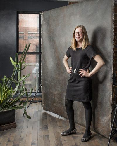 Andrea Harden standing in her office.