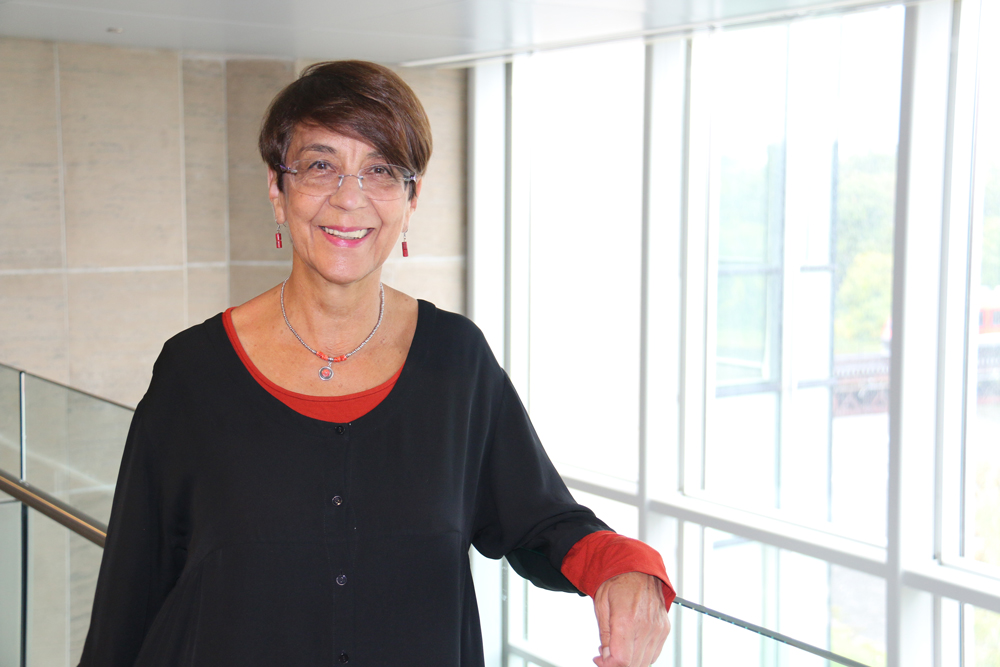 Professor Cristina Rojas stands in Richcraft Hll at Carleton University.