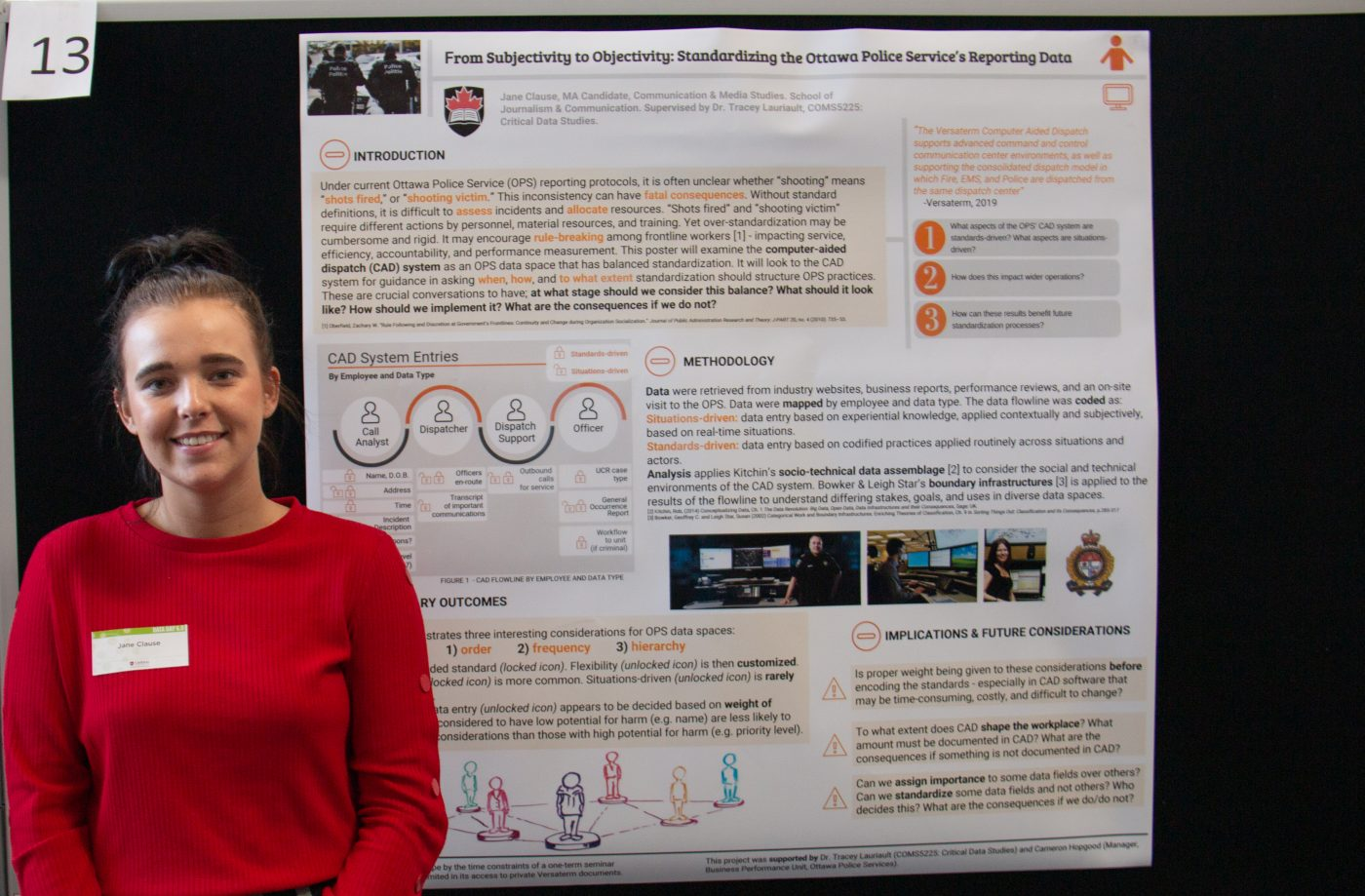 Jane Clause stands in front of her poster.
