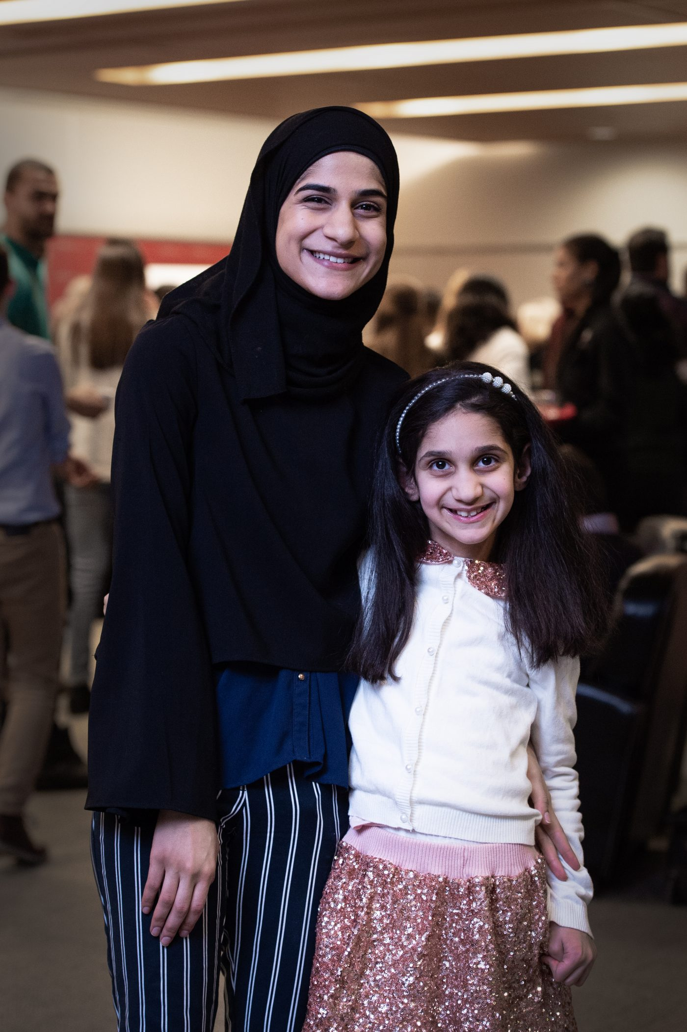 Fatma Alobeid poses with her little sister, Narjis.