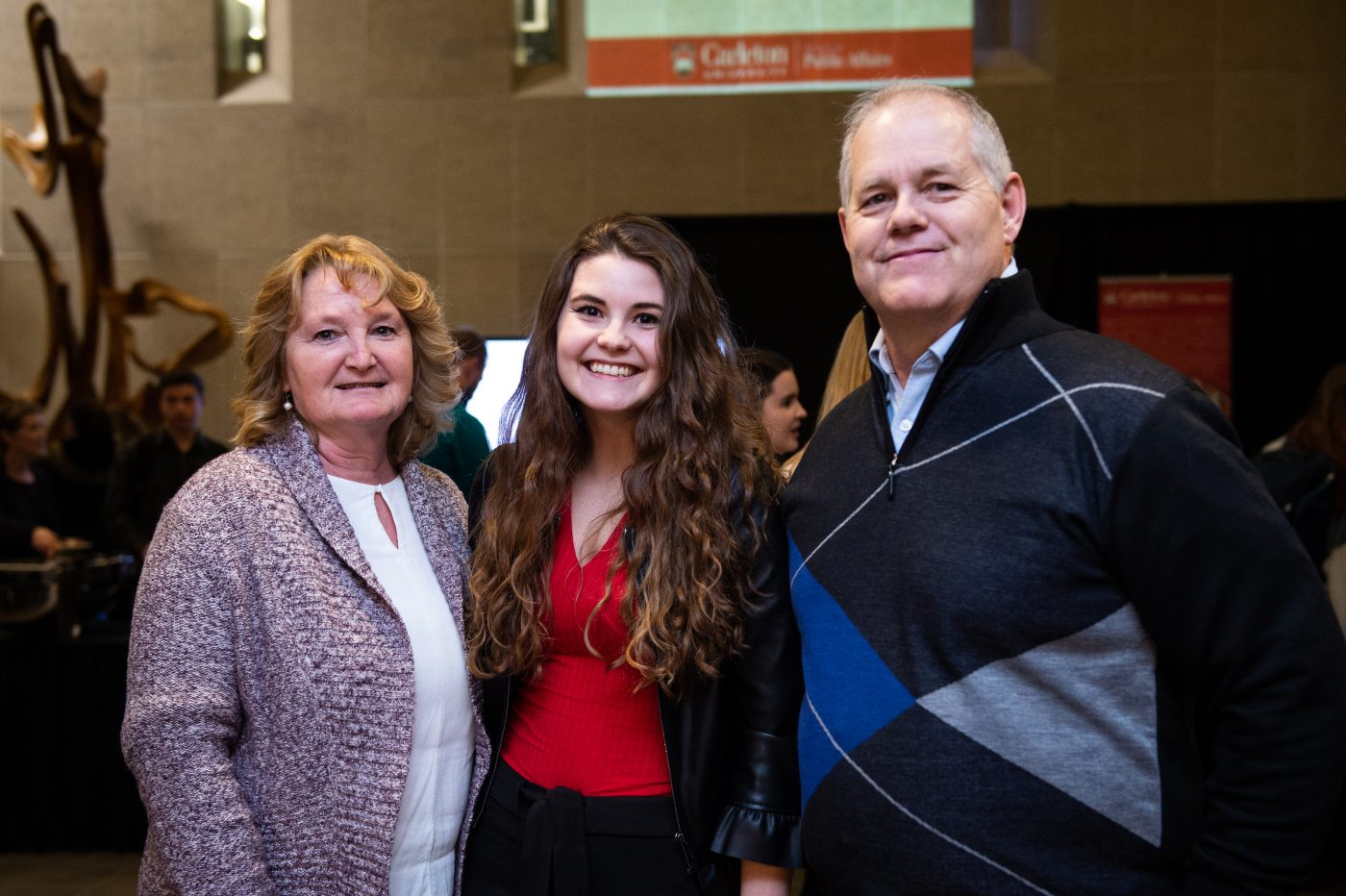 Katelyn Kornelsen poses with her parents.