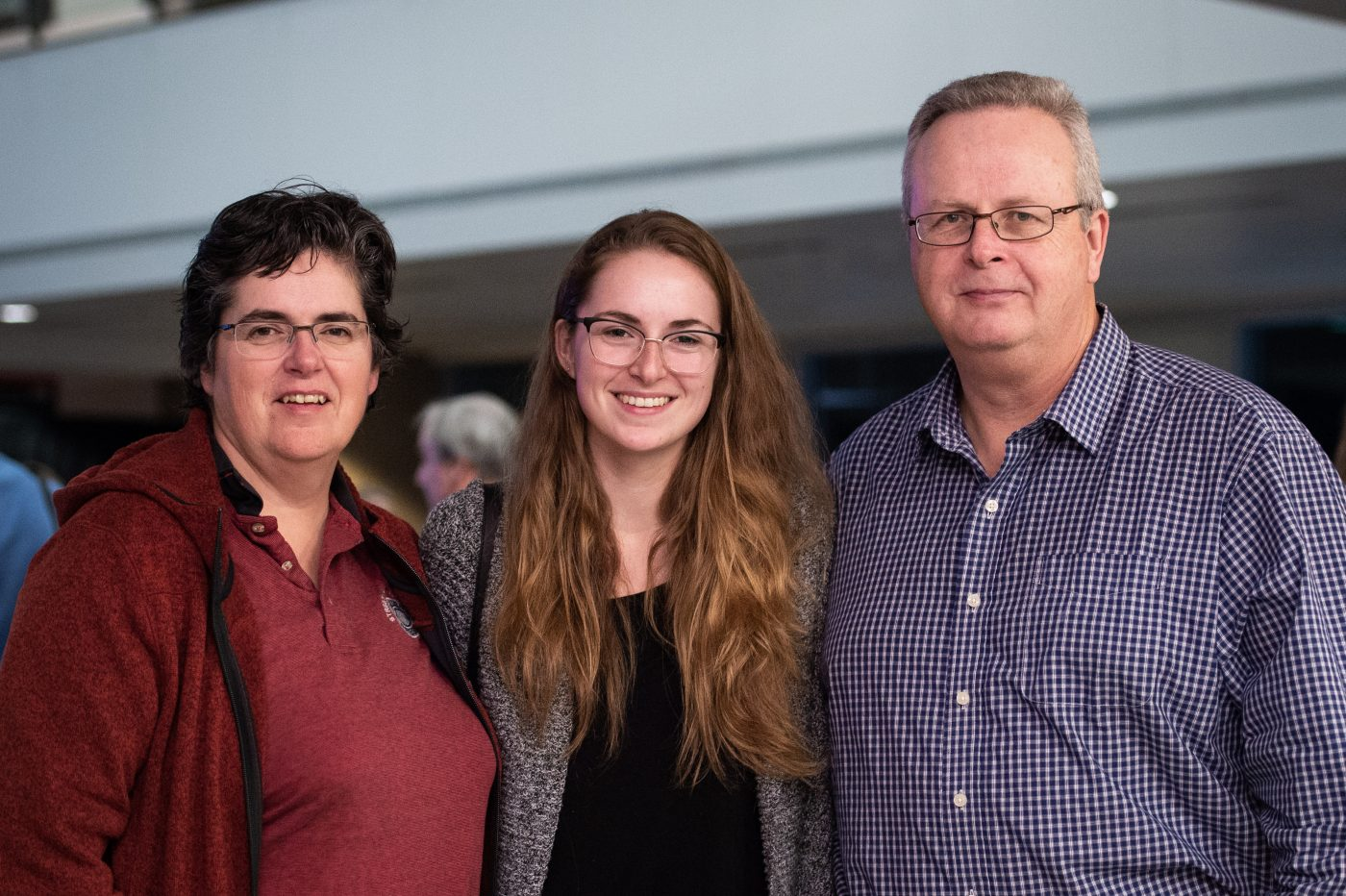 Lindsey MacMillan poses with her parents at the reception.