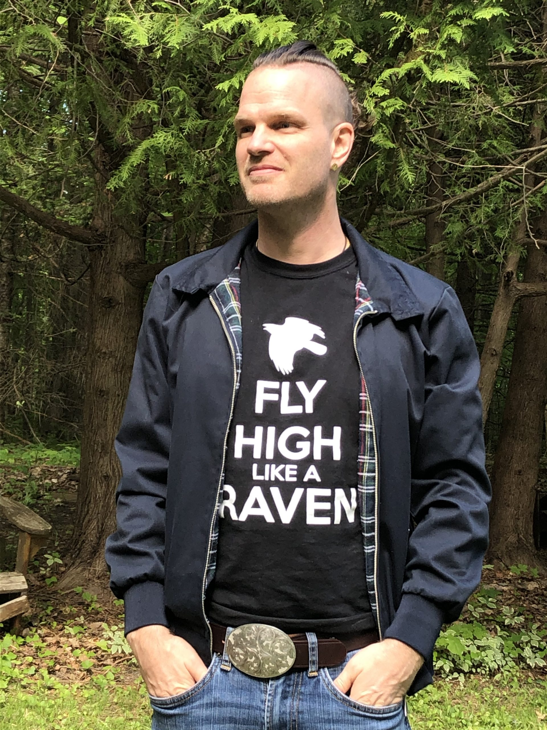"Seb Malette poses with ""Fly High Like a Raven"" t-shirt"