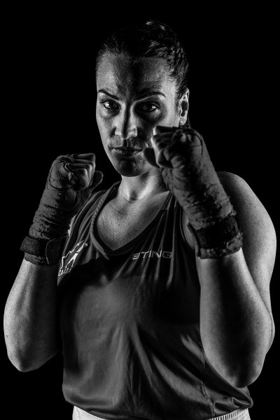 Marija Curran poses with her fists up for an official boxing portrait.