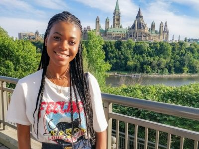 Raven Wilkinson poses in front of the parliament buildings in Ottawa.