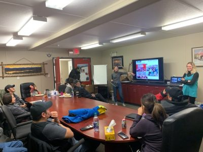 Jessica Leis (MA Sustainable Energy candidate), Alexandra Mallett, and several community members take part in a discussion session in Colville Lake, Northwest Territories.