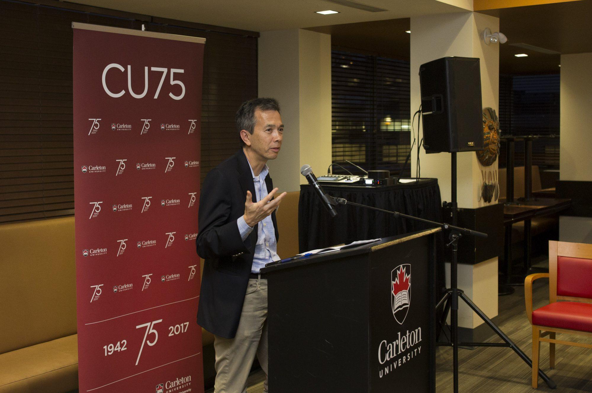 Greg Ip at a podium
