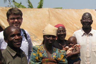 James Milner with refugees