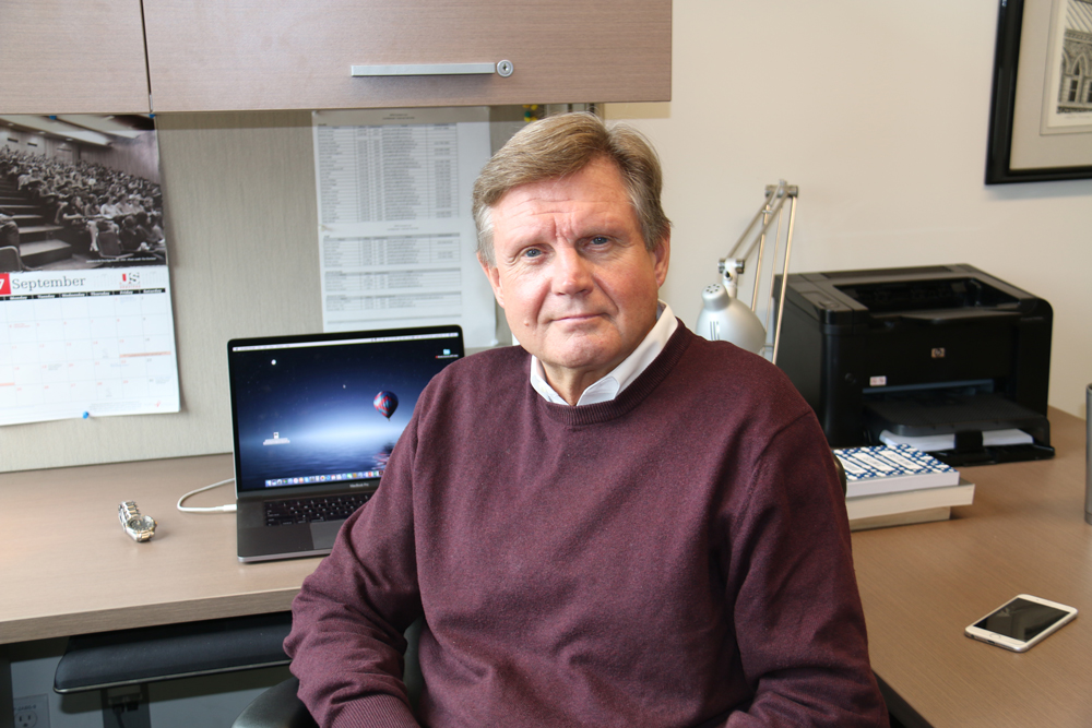 Leslie Pal sits in his office.