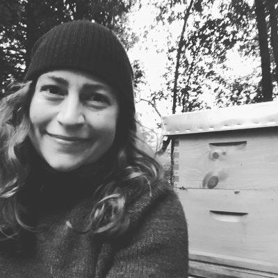 Sam Davidson poses next to a bee box