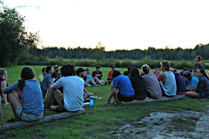 Students sitting out during sunset debriefing the days activities