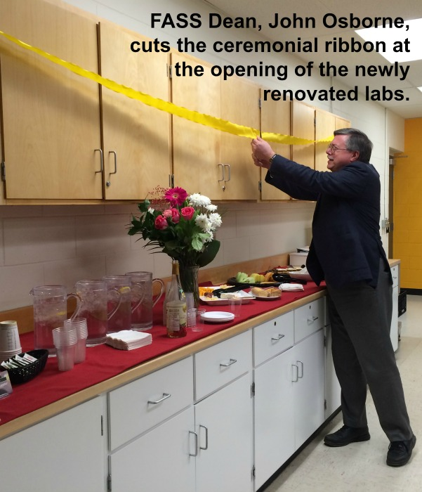 Photo of FASS Dean, John Osborne, cutting the ceremonial ribbon at the opening of the newly renovated labs.