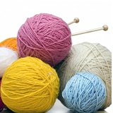 colorful yarn balls with needles