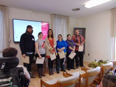 six undergraduate students standing in front of a room collecting their awards