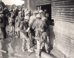 """Canadian soldiers line up to get a beer at a """"wet canteen"""" during the First World War"""