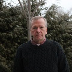 Greg Donaghy standing in front of trees