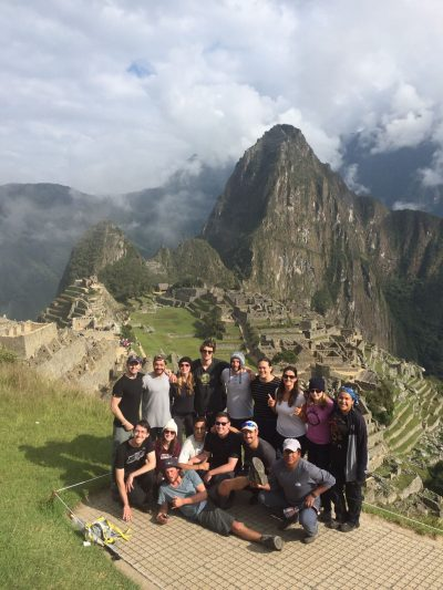 Evan Jones with others in front of Machu Picchu