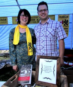 Kim Van Herk and Josh Blank staying dry under the tent at the book launch
