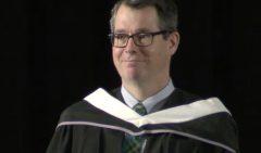 head shot of Jeff wearing a graduation robe