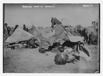black and white image of refugees near tents