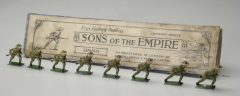 set of small toy soldiers in front of a folded newspaper