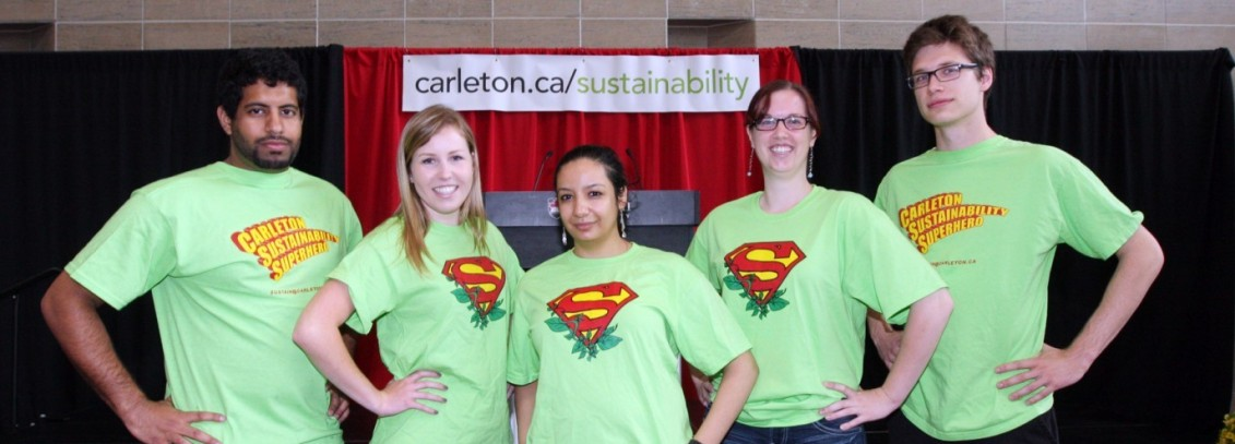 5 students standing infront of a sustainability banner