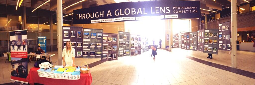 Panoramic photo of the atrium with a Global Lens banner
