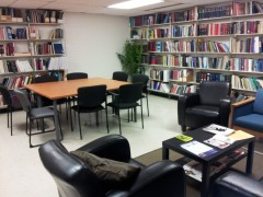 View of Chet Mitchell Law Resource Centre with workspaces and book shelves