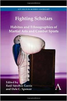 Book cover image_white boxing glove balanced on a book