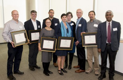 Migration and Diaspora Studies steering committee. From left to right: Christopher Worswick, James Milner, Ming Tiampo, Daniel McNeil, Catherine Khordoc, Sarah Casteel, Howard Duncan, Jeff Sahadeo, and Nimal Rajapakse (Vice-President Research and International). Photo credit: Justin Tang.