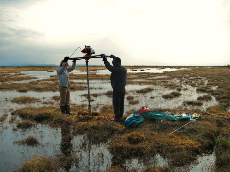 Zoë Braul and Ashlyn Frost extracting a permafrost core from a drained lake basin, Old Crow Flats, YT. (June 2010, Pascale Roy-Léveillée