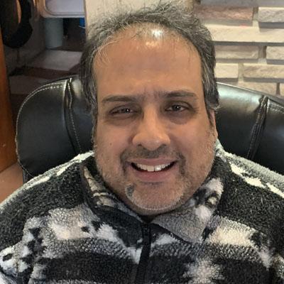 A photo of Ravi Malhotra, a Carleton University Political Science Alumni.
