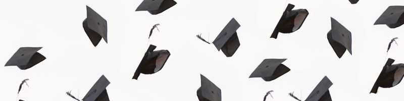 A photo illustration of graduating caps flying in the air.