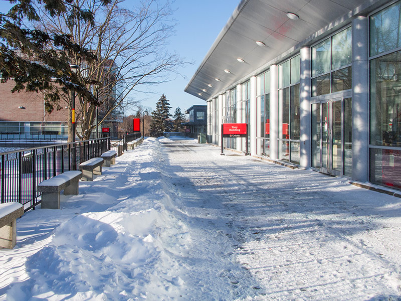 A wintertime photo of the outside of the Tory Building on the Carleton University campus.