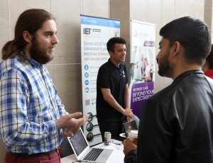 Vendor speaking with attendee at Enable 2019 event