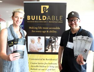 Representatives from BuildAble at their booth at Enable 2019 Event
