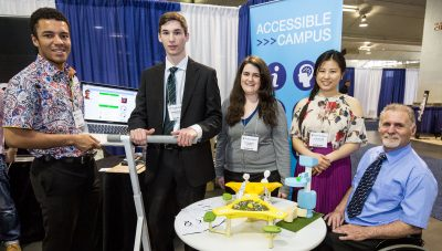 READ Director Dean Mellway (left) with Carleton undergraduate student finalists,  (left to right, Quayce Thomas, Brendan O'Brien, Dayna Conway and Jin Kyung Kim) and their projects at the 2015 IDEA finale, May 29, 2015, at the People in Motion Exhibition