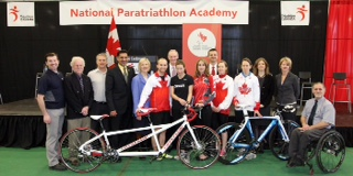 Group photo of enthusiasts at the National Paratriathalon Academy launch, including members of Paratriathalon Canada, government officials, Carleton University representatives and Canadian Paralymic Committee representatives.