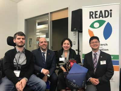 Symposium Speaker, Charles Watters, Carleton President, Benoit-Antoine Bacon, Associate Deputy Minister, Infrastructure and Communities and Symposiun Panelist, Yazmine Laroche, and READi Director, Adrian Chan, posing and smiling together.