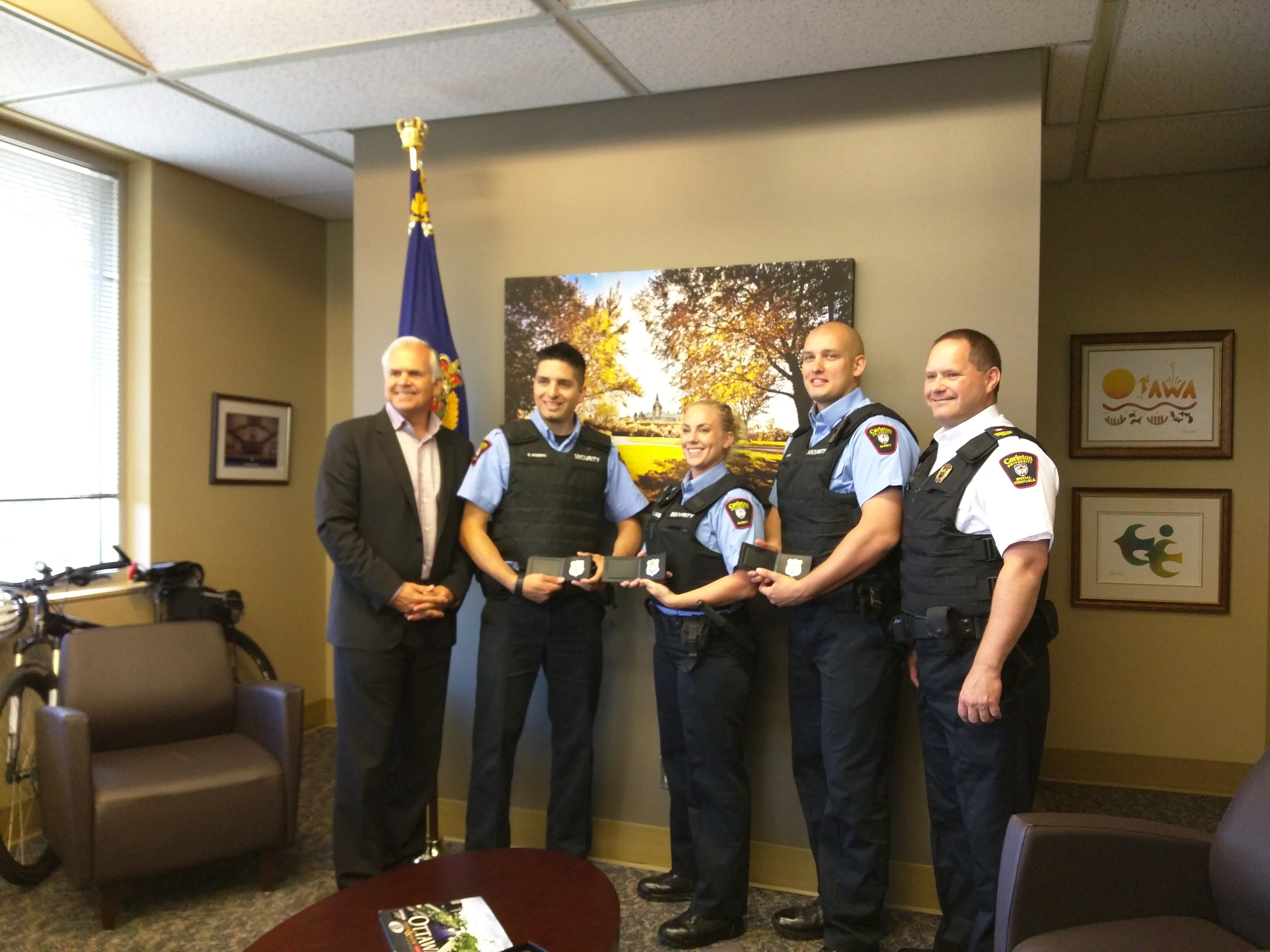 Ottawa Police Chief Charles Bordeleau, S/Cst Benjamin Moberg, S/Cst Laura Lalonde, S/Cst Nicholas Saucier, Acting Assistant Director Christopher Moy