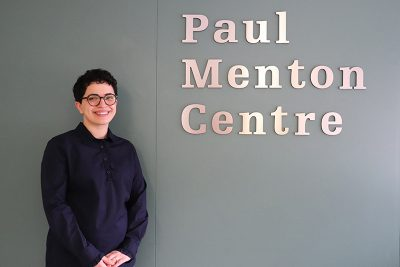 Frohan Foroutan, the 2019 Board Award Recipient standing in front of the entrance to the Carleton University Paul Menton Centre for Students with Disabilities.