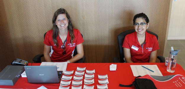 summer orientation leaders at a registration table