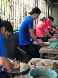 Two advisors and two Team Leaders make pottery in Nicaragua
