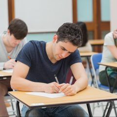 student writing an exam
