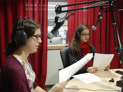 Students doing a mock radio broadcast