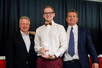 Craig Lord (center) receives his award from (left) Paul LaBarge, founding partner at LaBarge Weinstein LLP and (right) John Reid, CEO of CATA Alliance.