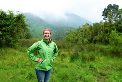 A graduate student Beatrice in a field